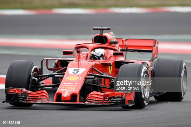 Ferrari's German driver Sebastian Vettel drives at the Circuit de Catalunya on February 27 2018 in Montmelo on the outskirts of Barcelona during the...