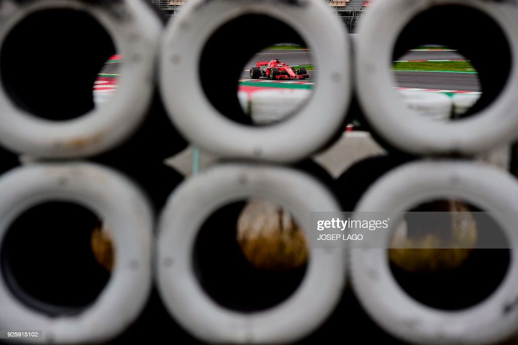 TOPSHOT - Ferrari's German driver Sebastian Vettel drives at the Circuit de Catalunya on March 1, 2018 in Montmelo on the outskirts of Barcelona during the fourth day of the first week of tests for the Formula One Grand Prix season. / AFP PHOTO / Josep LAGO