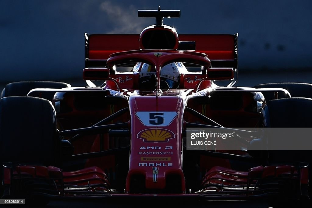 TOPSHOT - Ferrari's German driver Sebastian Vettel drives at the Circuit de Catalunya on March 6, 2018 in Montmelo on the outskirts of Barcelona during the first day of the second week of tests for the Formula One Grand Prix season. /