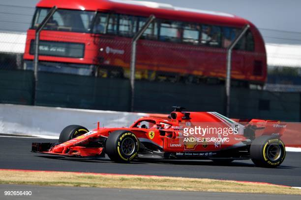 Ferrari's German driver Sebastian Vettel drives during first practice at Silverstone motor racing circuit in Silverstone central England on July 6...