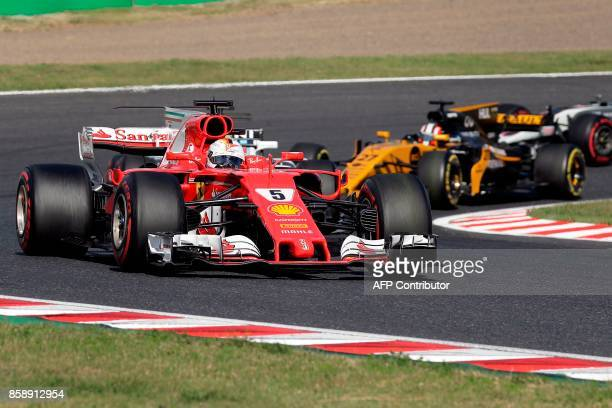 Ferrari's German driver Sebastian Vettel drives during the Formula One Japanese Grand Prix at Suzuka on October 8 2017 / AFP PHOTO / Kiyoshi OTA