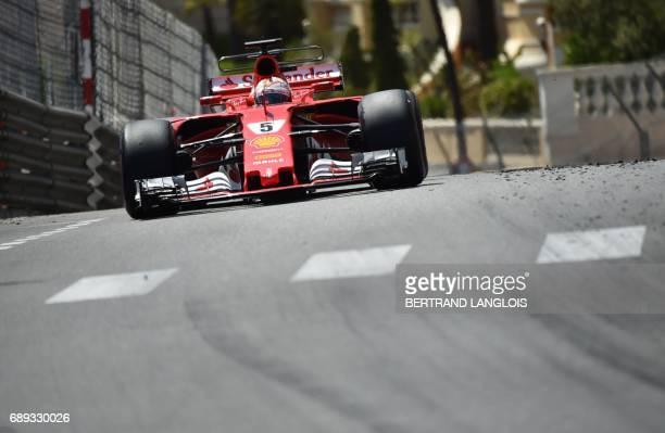 TOPSHOT Ferrari's German driver Sebastian Vettel drives during the Monaco Formula 1 Grand Prix at the Monaco street circuit on May 28 2017 in Monaco...
