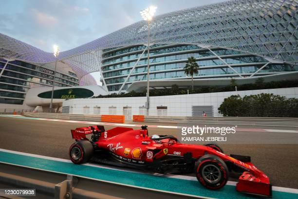 Ferrari's German driver Sebastian Vettel drives during the qualifying session on the eve of the Abu Dhabi Formula One Grand Prix at the Yas Marina...