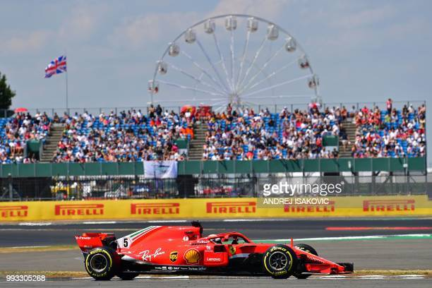 Ferrari's German driver Sebastian Vettel drives during the qualifying session at Silverstone motor racing circuit in Silverstone central England on...