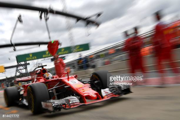 TOPSHOT Ferrari's German driver Sebastian Vettel drives during the second practice session at the Silverstone motor racing circuit in Silverstone...