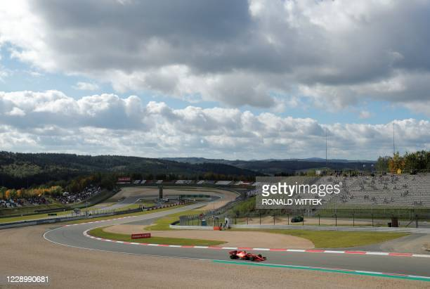 Ferrari's German driver Sebastian Vettel drives during the third practice session at the Nuerburgring circuit in Nuerburg, western Germany, on...