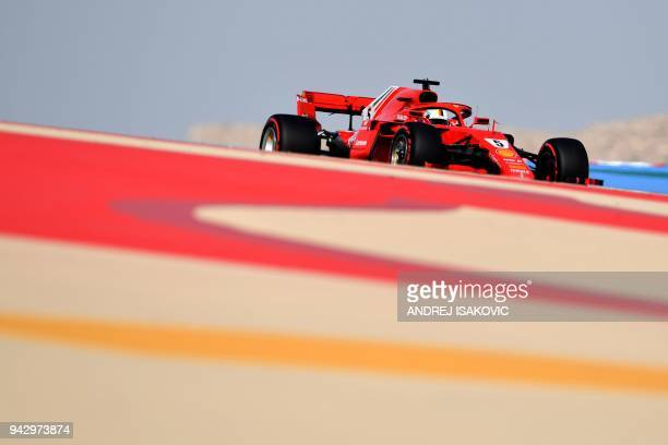 TOPSHOT Ferrari's German driver Sebastian Vettel drives during the third practice session on April 7 prior to the qualifiers for the Bahrain Formula...