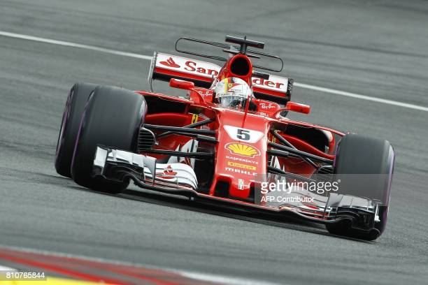 Ferrari's German driver Sebastian Vettel drives his car during the qualifying session of the Formula One Austria Grand Prix at the Red Bull Ring in...