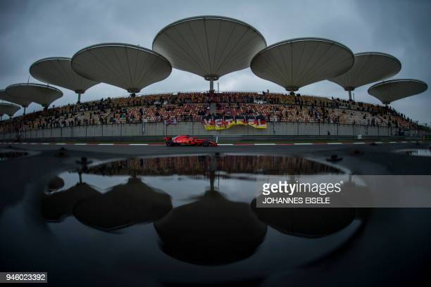 TOPSHOT Ferrari's German driver Sebastian Vettel drives on the straight during a practice session for the Formula One Chinese Grand Prix in Shanghai...