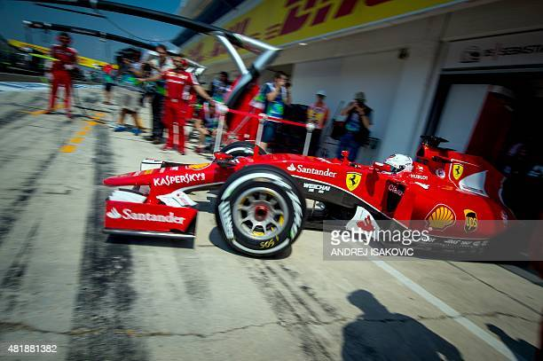 Ferrari's German driver Sebastian Vettel drives out of the pits during the third practice session at the Hungaroring circuit near Budapest on July 25...