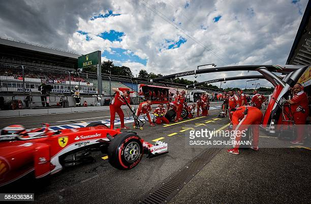 Ferrari's German driver Sebastian Vettel drives through the pit lane during the second practice session ahead of the Formula One Grand Prix of...