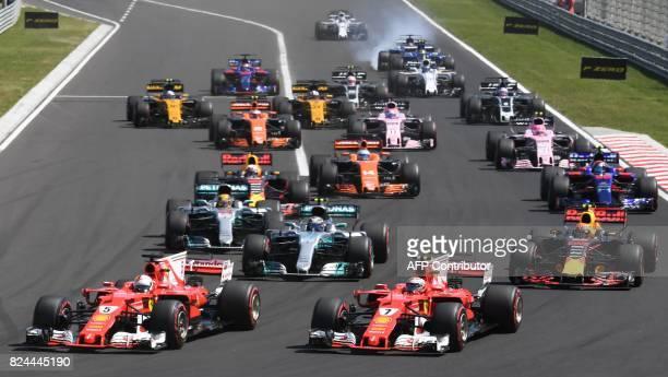 Ferrari's German driver Sebastian Vettel Ferrari's Finnish driver Kimi Raikkonen and other pilots race at the Hungaroring circuit in Budapest on July...
