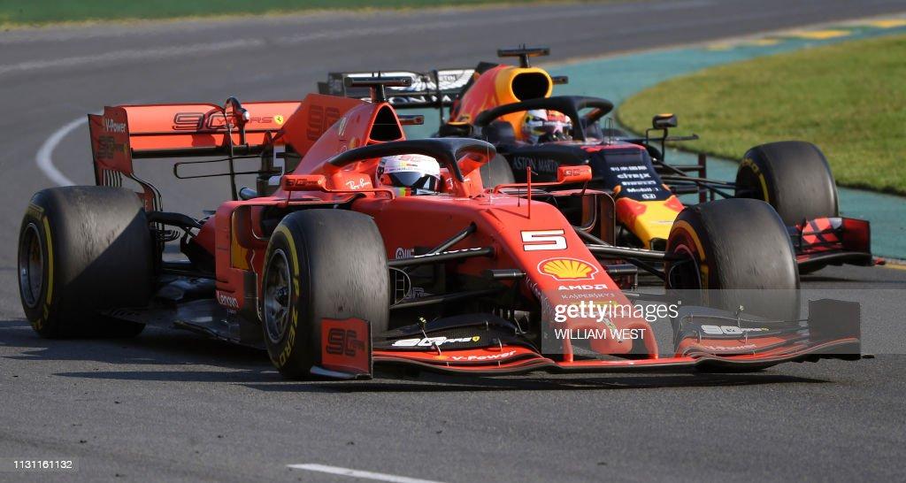 f2895838 Ferrari's German driver Sebastian Vettel is challenged by Red Bull ...