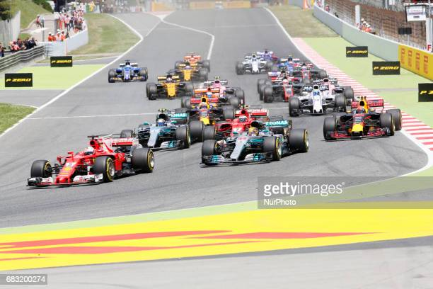 Ferrari's German driver Sebastian Vettel leads after the start of the Spanish Formula One Grand Prix at the Circuit de Catalunya on May 14 2017 in...