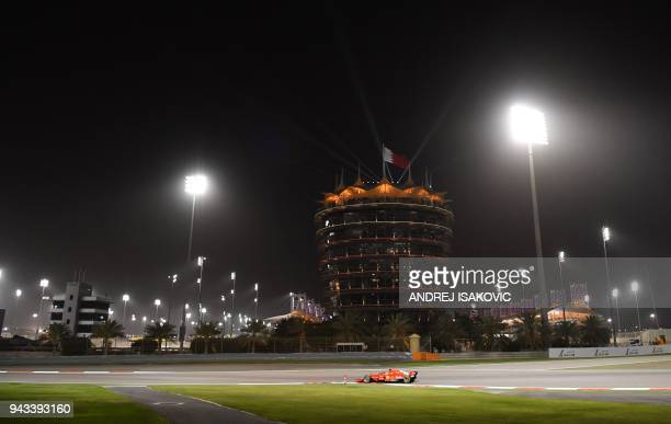 TOPSHOT Ferrari's German driver Sebastian Vettel leads during the Bahrain Formula One Grand Prix at the Sakhir circuit in Manama on April 8 2018 /...