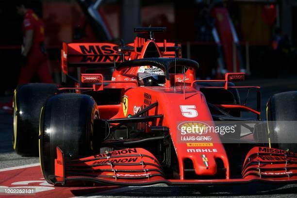 Ferrari's German driver Sebastian Vettel leaves the pits during the tests for the new Formula One Grand Prix season at the Circuit de Catalunya in...