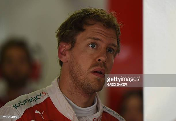 Ferrari's German driver Sebastian Vettel looks at a screen in his pit garage after the second practice session for the Formula One Chinese Grand Prix...