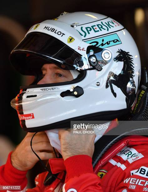 Ferrari's German driver Sebastian Vettel prepares for the first Formula One practice session in Melbourne on March 23 ahead of the Formula One...