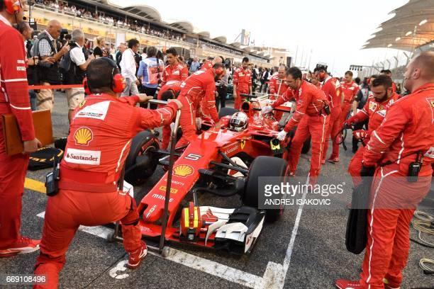 Ferrari's German driver Sebastian Vettel prepares on the strating grid aheahd of during the Bahrain Formula One Grand Prix at the Sakhir circuit in...