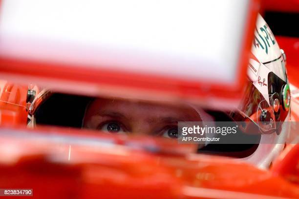 Ferrari's German driver Sebastian Vettel prepares to take part in a practice session at the Hungaroring racing circuit in Budapest on July 28 2017...