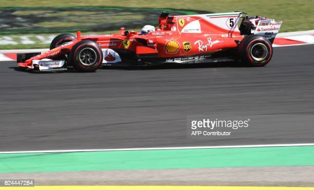 Ferrari's German driver Sebastian Vettel races at the Hungaroring circuit in Budapest on July 30 during the Formula One Hungarian Grand Prix / AFP...