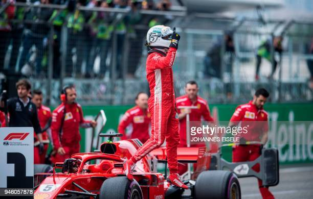 TOPSHOT Ferrari's German driver Sebastian Vettel reacts after qualifying in pole position for the Formula One Chinese Grand Prix in Shanghai on April...