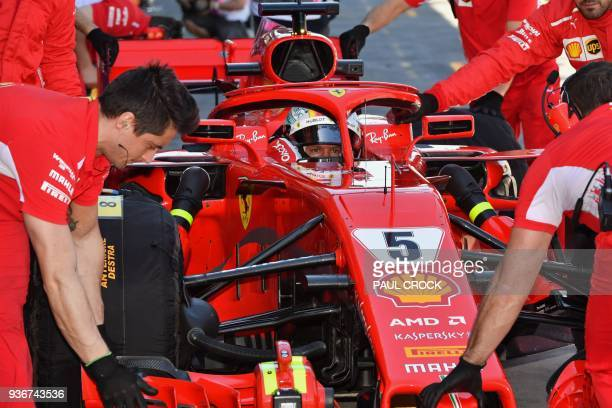 Ferrari's German driver Sebastian Vettel returns to the pit during the first Formula One practice session in Melbourne on March 23 ahead of the...