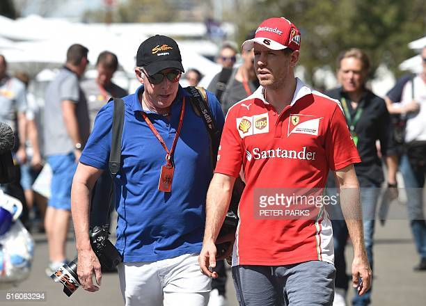 Ferrari's German driver Sebastian Vettel speaks to a photographer in the paddock during the build up to the Formula One Australian Grand Prix in...