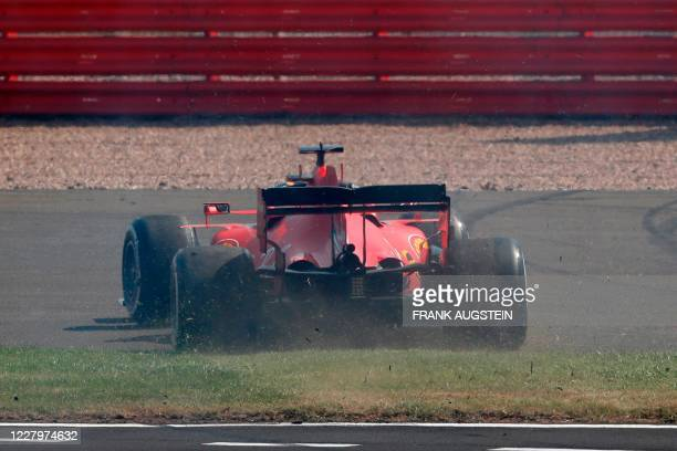 Ferrari's German driver Sebastian Vettel spins off the track on the first lap during the F1 70th Anniversary Grand Prix at Silverstone on August 9...