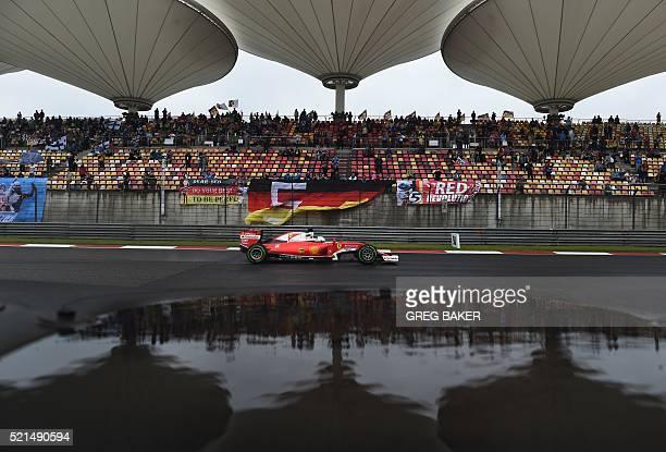 TOPSHOT Ferrari's German driver Sebastian Vettel steers his car during practice for the Formula One Chinese Grand Prix in Shanghai on April 16 2016 /...