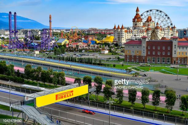 TOPSHOT Ferrari's German driver Sebastian Vettel steers his car during the second practice session of the Formula One Russian Grand Prix at the Sochi...