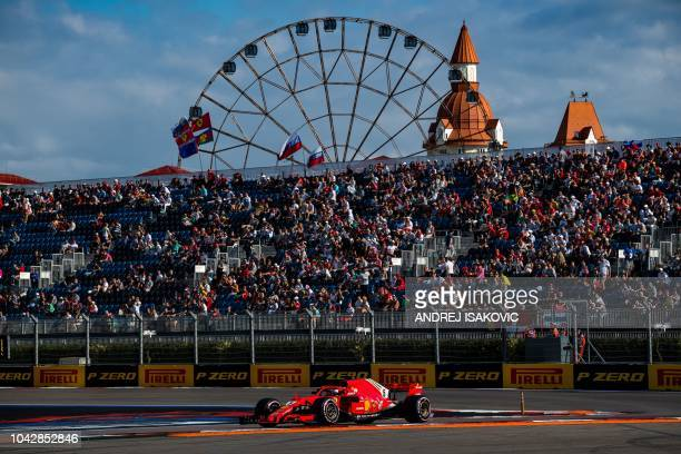 Ferrari's German driver Sebastian Vettel steers his car during the qualifying session for the Formula One Russian Grand Prix at the Sochi Autodrom...