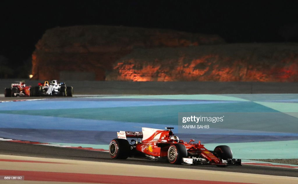 Ferrari's German driver Sebastian Vettel steers his car during the Bahrain Formula One Grand Prix at the Sakhir circuit in Manama on April 16, 2017. Vettel moved into a clear lead in this years world championship when he claimed a well-judged victory for Ferrari in the Bahrain Grand Prix for his second win of the season. /