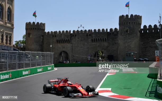 Ferrari's German driver Sebastian Vettel steers his car during the first practice session of the Formula One Azerbaijan Grand Prix at the Baku City...
