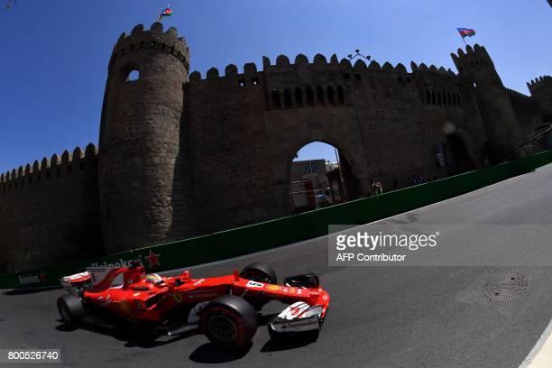 Ferrari's German driver Sebastian Vettel steers his car during the third practice session of the Formula One Azerbaijan Grand Prix at the Baku City...