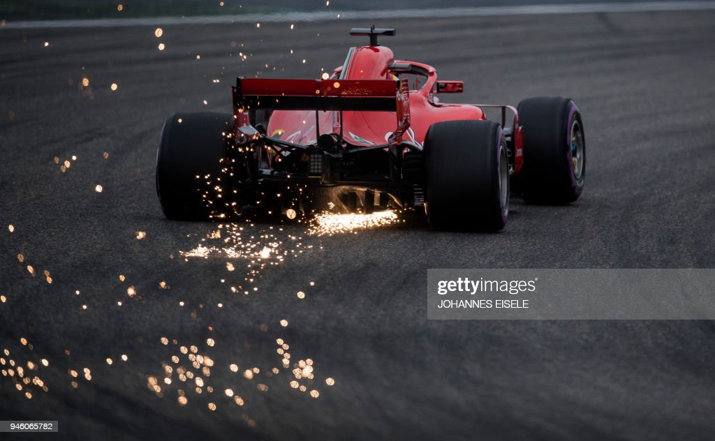 TOPSHOT - Ferrari's German driver Sebastian Vettel steers his car during the qualifying session for the Formula One Chinese Grand Prix in Shanghai on April 14, 2018. / AFP PHOTO / Johannes EISELE