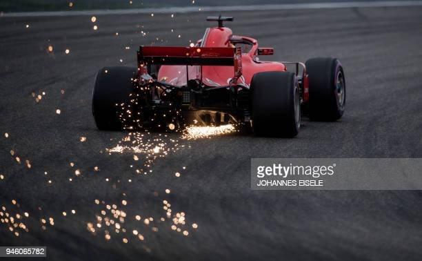 TOPSHOT Ferrari's German driver Sebastian Vettel steers his car during the qualifying session for the Formula One Chinese Grand Prix in Shanghai on...