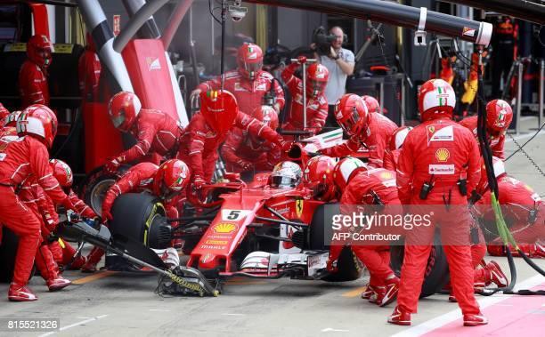Ferrari's German driver Sebastian Vettel stops in the pits during the British Formula One Grand Prix at the Silverstone motor racing circuit in...