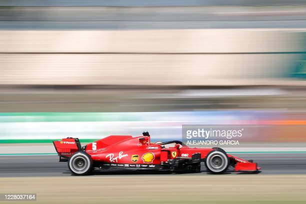 TOPSHOT Ferrari's German driver Sebastian Vettel takes part in the first practice session at the Circuit de Catalunya in Montmelo near Barcelona on...
