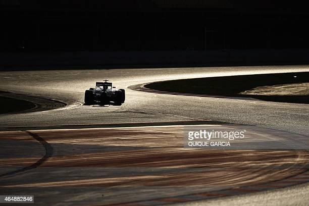 Ferrari's German driver Sebastian Vettel takes part in the fourth and last segment of Formula One preseason tests at the Circuit de Catalunya in...