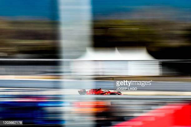 TOPSHOT Ferrari's German driver Sebastian Vettel takes part in the tests for the new Formula One Grand Prix season at the Circuit de Catalunya in...