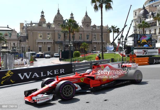 Ferrari's German driver Sebastian Vettel test drives during the first practice session at the Monaco street circuit, on May 25, 2017 in Monaco, three...