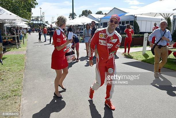Ferrari's German driver Sebastian Vettel walks through the paddock during the build up to the Formula One Australian Grand Prix in Melbourne on March...