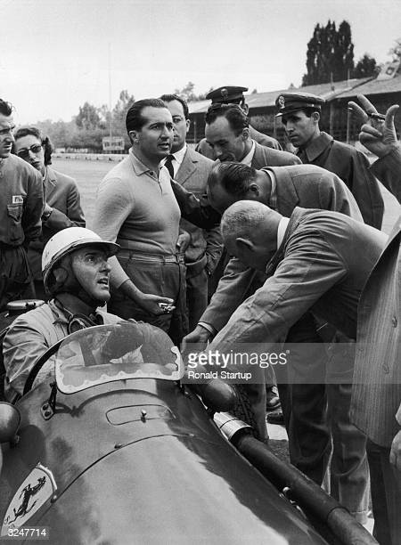 Italian racing driver Giuseppe Farina with the Ferrari team before the line up for the Italian Grand Prix at Monza Behind him is team mate Alberto...