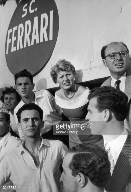 Supporters of the Ferrari racing team watch the Italian Grand Prix at Monza with mounting tension Juan Manuel Fangio's Maserati won the race with...