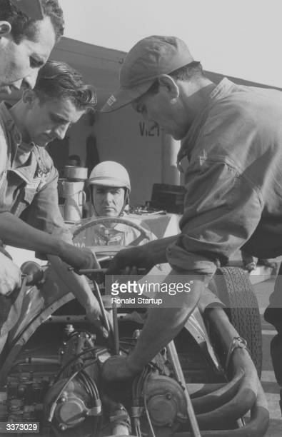 Engineers change spark plugs on the Ferrari of Dr Giuseppe Farina a lawyer and successful motor racer he became the first ever world champion at...