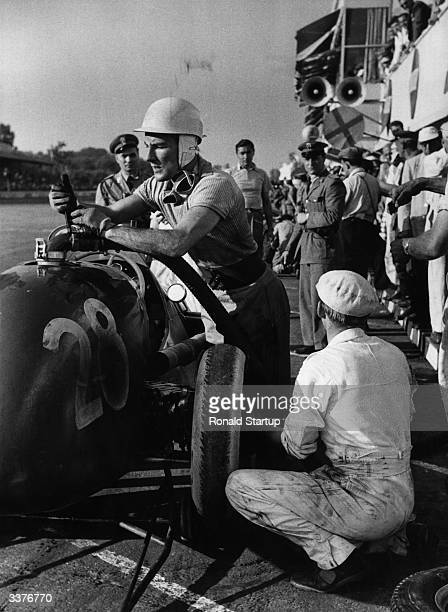 The British Motor Racing driver Stirling Crauford Moss supervises the filling of his petrol tank at Monza Italy Original Publication Picture Post...