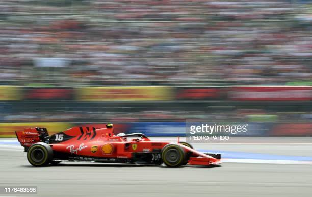 Ferrari's Monaco driver Charles Leclerc powers his car during the F1 Mexico Grand Prix at the Hermanos Rodriguez racetrack in Mexico City on October...