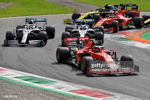 Ferrari's Monegasque driver Charles Leclerc competes ahead of Mercedes' British driver Lewis Hamilton and Mercedes' Finnish driver Valtteri Bottas...