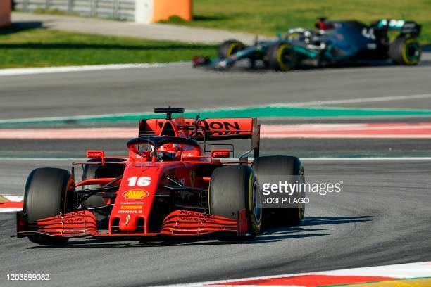 Ferrari's Monegasque driver Charles Leclerc drives followed by Mercedes' British driver Lewis Hamilton during the tests for the new Formula One Grand...
